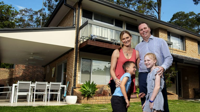 Mark and Julie Donovan, with their children Keira and Bailey at their solar-powered home in Grays Point.