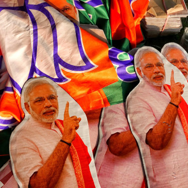 Cutouts of Modi before a rally in Kolkata.