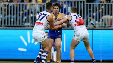 Retribution: Eagle Andrew Gaff was taken from the field after being double-teamed in a tackle by Michael Johnson and Luke Ryan of the Dockers.