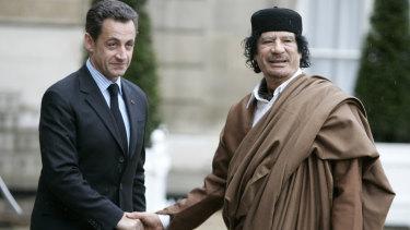 Libyan dictator Muammar Gaddafi (right) with then French president Nicolas Sarkozy in Paris in 2007.