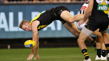 Hitting the turf: Richmond's Jack Riewoldt injured his wrist in this incident during the round 2 clash against Collingwood.
