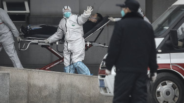 Medical staff transfer patients to Jin Yintan hospital in Wuhan. News of the deadly virus has traders concerned about the impact on market stability.