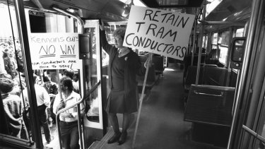 Ms Julie Di-Mieri makes her protest on board a tram in the Bourke Street Mall during a public transport stop work.