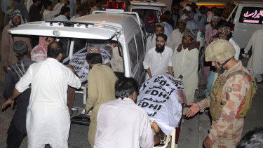People taking bodies of bombing victims to their villages for burial at a hospital in Quetta, Pakistan.