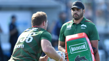 Sidelined: An injured Greg Inglis holds the pads at Souths training at Sunshine Coast Stadium.