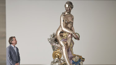 Artist Jeff Koons with his sculpture at the National Gallery of Victoria.
