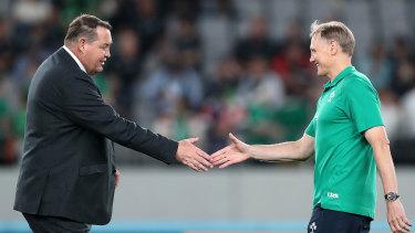 Head to head: Steve Hansen greets his Ireland counterpart and countryman, Joe Schmidt, before their quarter-final.