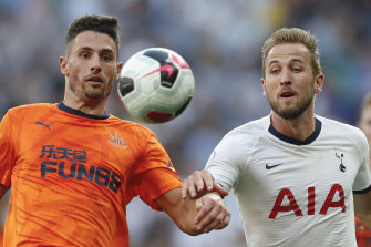 Newcastle's Fabian Schar and Tottenham's Harry Kane challenge for the ball.