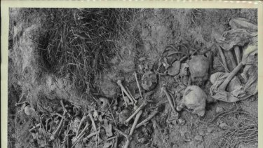 In open trenches are the skulls and bones of some of the thousands murdered by the Khmer Rouge.