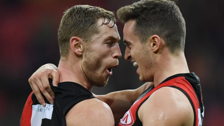 Bombers Orazio Fantasia and Devon Smith are embracing victory.