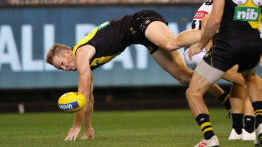 Hitting the turf: Richmond's Jack Riewoldt injured his wrist after attempting a mark during the round two clash against Collingwood.