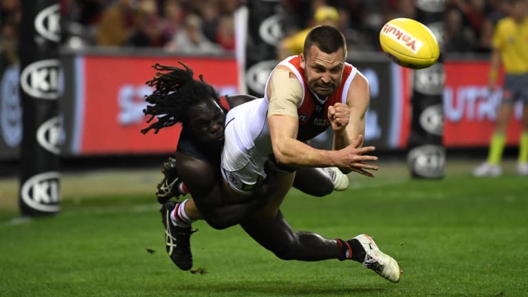 Essendon's Anthony McDonald-Tipungwuti tackles St Kilda's Jarryn Geary.