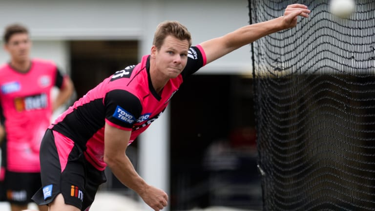 Back in the game: Steve Smith rolls his arm over in a net session for the Sydney Sixers.