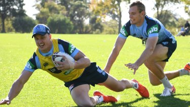 Learning the ropes: Jack Wighton goes to ground with Tom Trbojevic following at Blues training.