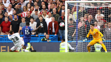 Self-inflicted: Kurt Zouma of Chelsea scores an own goal during Sheffield United's upset draw at Stamford Bridge.