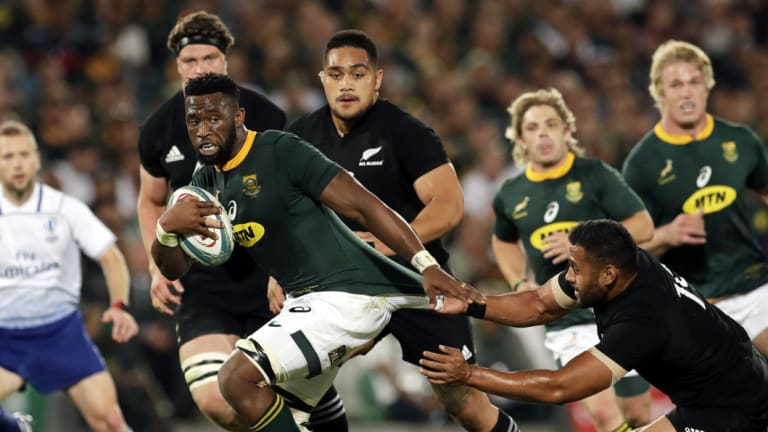 Stymied: South African captain Siya Kolisi is challenged by New Zealand's Patrick Tuipulotu,