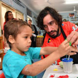 'That's the one thing that I regretted; that I didn't apply myself (at school) to have something to fall back on.' Johnathan Thurston with children from the Camp Koobara Aboriginal and Torres Strait Islander Kindergarten in Brisbane.