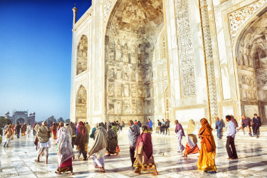 Tourists visit the Taj Mahal in Agra, India.