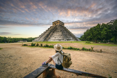 <p>One woman admiring Kukulkan pyramid at Chichen-Itza archaeological site, Yucatan, Mexico</p>