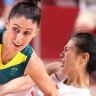 Katie Ebzery and Siyu Wang fight for possession.