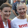 Serbian Prime Minister Ana Brnabic, left, and her partner Milica Djurdjic smile during the annual pride march in Belgrade, Serbia.