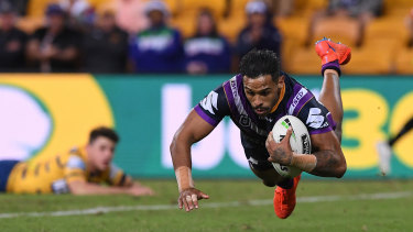 Blow-out: Josh Addo-Carr scores one of his two tries in Melbourne's demolition of Parramatta on Saturday.