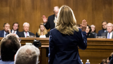 Dr Ford is sworn before giving testimony before Republican and Democrat senators.