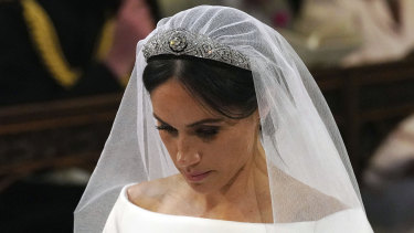 Meghan Markle wore the Queen Mary's diamond bandeau tiara, lent to her by the Queen.