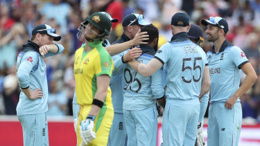 England players celebrates after the dismissal of key man Steve Smith.