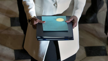 Clerk of the House Cheryl Johnson carries the articles of impeachment against President Donald Trump to the Senate, on Capitol Hill in Washington.