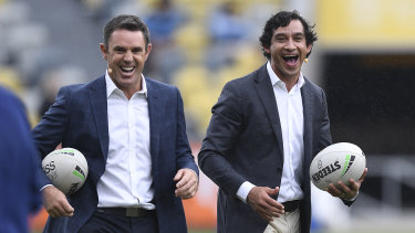 Brad Fittler and Johnathan Thurston share a laugh before resuming their duties as TV commentators.