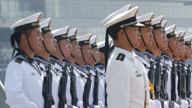 Chinese People's Liberation Navy sailors stand in formation.