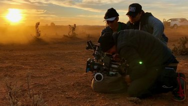 """The whole community actually loves movies"": director Heath Davis (rear) with director of photography Chris Bland and focus puller Jeffrey Truong on the set of the film Locusts at Broken Hill."