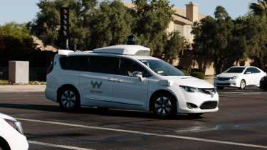 A Waymo autonomous vehicle passes through an intersection in Chandler, Arizona.
