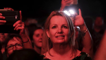 Environment Minister Sussan Ley watches from the crowd as Peter Garrett from Midnight Oil performed at the celebrations.