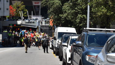 Protesters head from the convention centre to Parliament.
