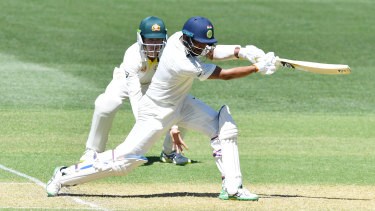 Stalwart: Pujara drives during a knock antithetical to the modern crash and bash game.