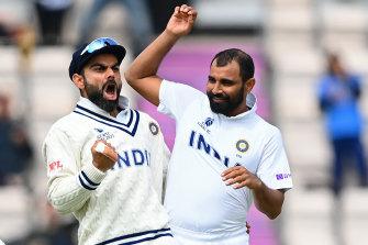 Virat Kohli and Mohammed Shami celebrate the wicket of Colin de Grandhomme.
