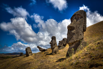 Moais at the Easter Island, a territory of Chile. Moais are human figures carved by the Rapa Nui people in rock.
