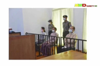 An image of Aung San Suu Kyi, left, in court in Naypyitaw last month was shown on military-run television.