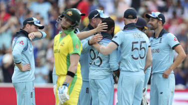 England's Adil Rashid celebrates with teammates after dismissing Steve Smith.