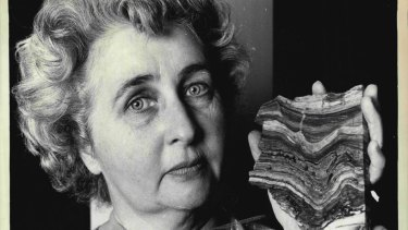 "Paleobotanist Mary White pictured with a piece of stromatolite dated 3,500 million years old, the oldest recorded evidence of ""plant"" life, found in Western Australia. August 21, 1981."