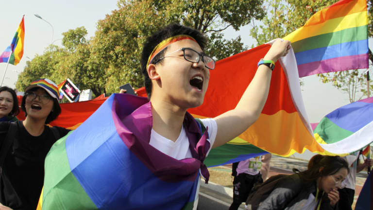 "Gay identity in China: More than 20,000 people take part in a ""Rainbow Marathon,"" organised to raise awareness of LGBT issues in Nanjing in eastern China's Jiangsu province."