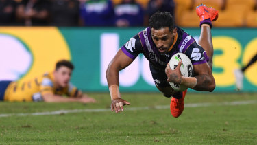 Josh Addo-Carr scores one of his two tries in Melbourne's demolition of Parramatta on Saturday.