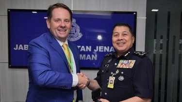 Senior AFP liaison officer Jason Byrnes with Wan Ahmad Najmuddin bin Mohd in 2017.