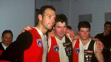 Danny Frawley, centre, celebrates a Saints win with Stuart Loewe and Robert Harvey in 1995.
