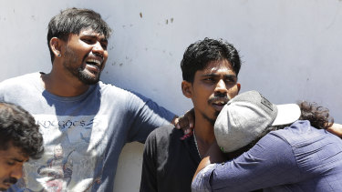 Relatives of people killed in Church blasts mourn as they wait outside mortuary of a hospital in Colombo, Sri Lanka.
