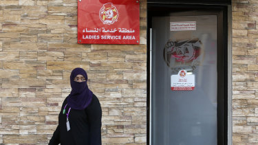 A woman leaves a ladies only service area at a restaurant in Jiddah, Saudi Arabia, on Sunday.