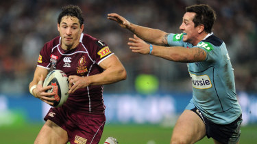 Billy Slater tries to escape Pearce's clutches.