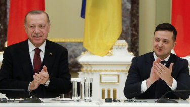 Ukrainian President Volodymyr Zelensky, right, and Turkey's President Recep Tayyip Erdogan applaud during a signing ceremony in Kiev, Ukraine.